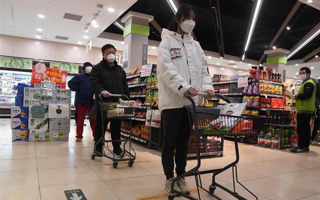 """""""Sóng"""" COVID-19 mới đe dọa tăng trưởng kinh tế Trung Quốc - Ảnh 1."""