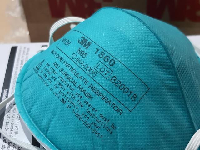 Hà Nội: Phát hiện 20.000 khẩu trang nghi làm giả chuẩn bị cung cấp cho một số bệnh viện - Ảnh 3.