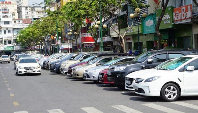 Giữa tháng 10, TP.HCM sẽ thu phí ô tô qua điện thoại di động - ảnh 1