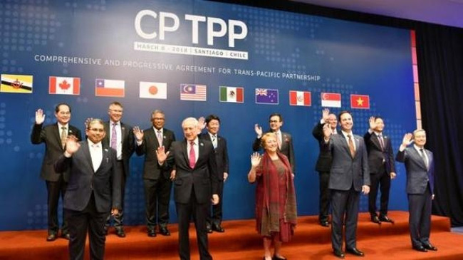 Representatives from 11 member countries gather in Santiago, Chile to sign the CPTPP trade pact. (Credit: Nikkei)
