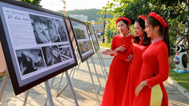 Visitors admiring photos at the exhibition