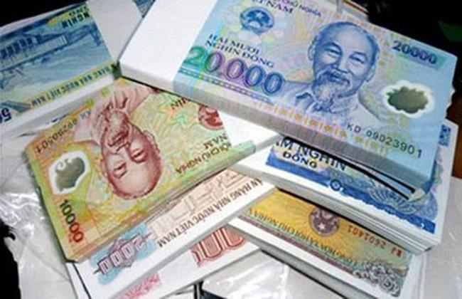 Sẽ xử lý nghiêm việc đổi tiền lẻ, tiền mới để hưởng chênh lệch - ảnh 1