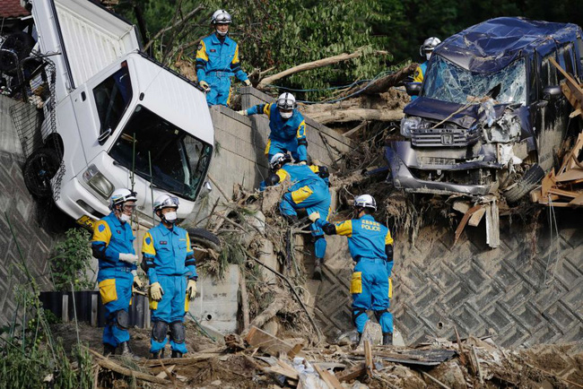 Rescuers continue to search for survivors in Kumano town, Hiroshima prefecture, as dozens of people remain missing. Photo: AP(Kota Endo/Kyodo News)