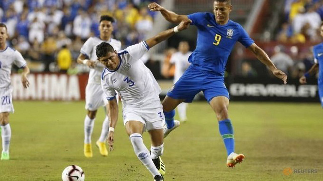 El Salvador defender Roberto Dom'nguez (3) and Brazil forward Richarlison (9) battle for the ball in the first half during an international friendly soccer match at FedEx Field. (Reuters)