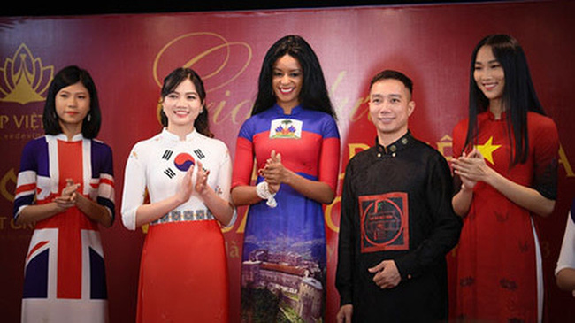 Fashion designer Do Trinh Hoai Nam (fourth from left) and models in his Ao Dai designs featuring the national flags of different countries