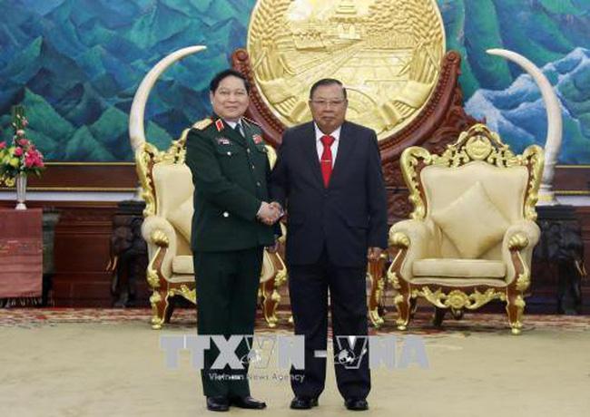 Đại tướng Ngô Xuân Lịch hội kiến với Tổng Bí thư, Chủ tịch nước Lào - ảnh 2