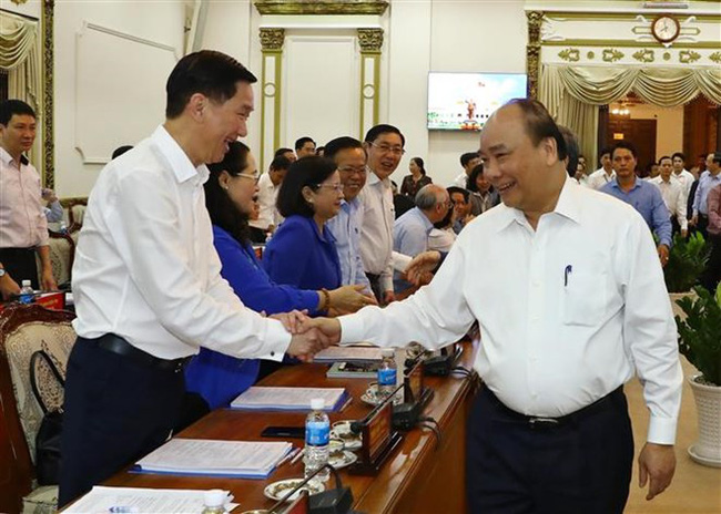 Prime Minister Nguyen Xuan Phuc and delegates at the conference. (Photo: VNA)