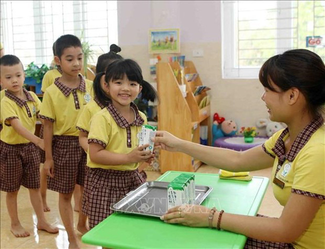 School milk programme has been implemented to ease malnutrition in the country. (Photo: VNA)