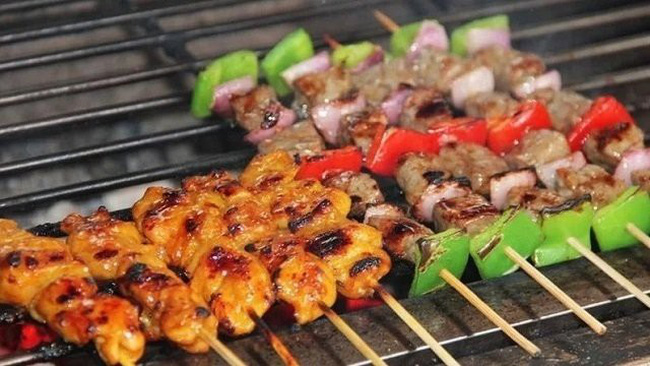 Grilled skewers are one of the most popular street foods in Ho Chi Minh City. (Photo by Shutterstock/Andy Tran)