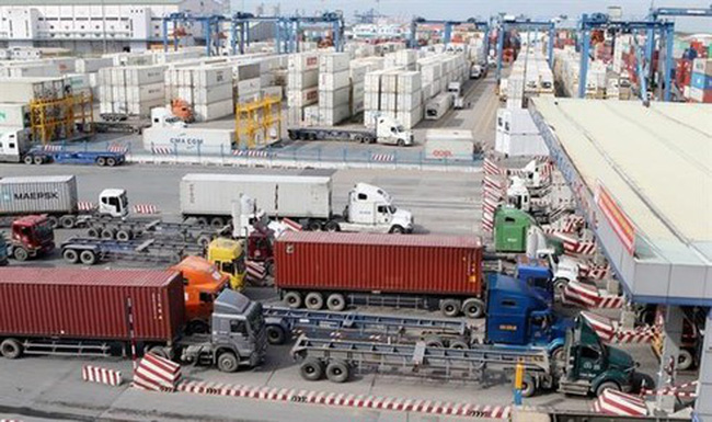 Trucks transfer containers to HCM City's Cat Lai Port, the common hub of plastic waste imported into Vietnam