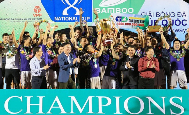 Hanoi FC players celebrate their first-ever National Cup trophy.