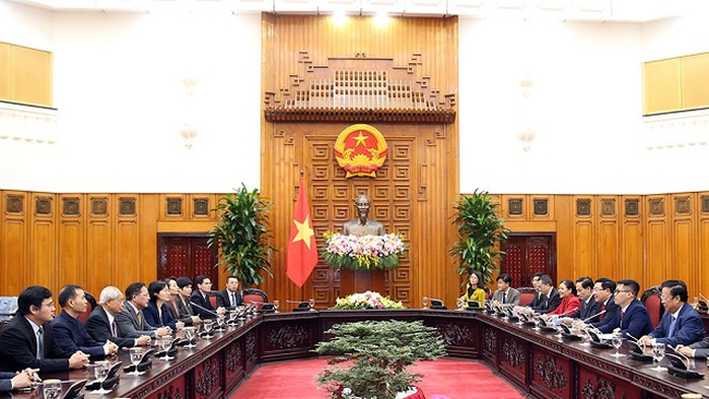 At the reception for delegates to the 11th Vietnam-China People's Forum. (Photo: VGP)
