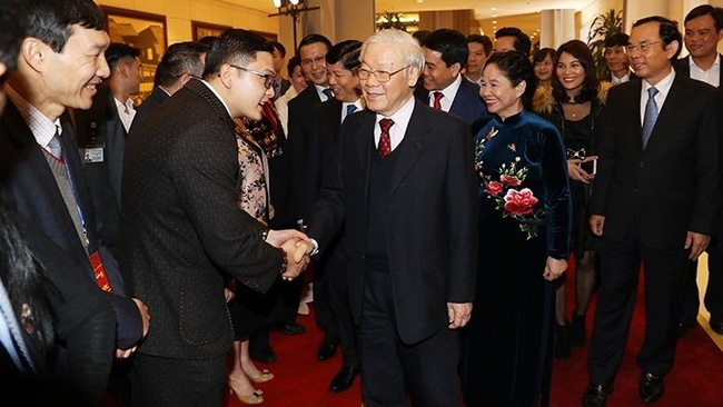 Party General Secretary and President Nguyen Phu Trong and overseas Vietnamese attend the programme (Photo: VNA)