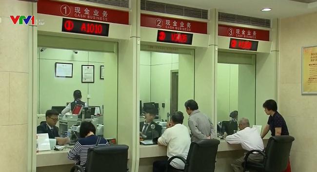 Trung Quốc nỗ lực duy trì tỷ giá hối đoái - ảnh 2