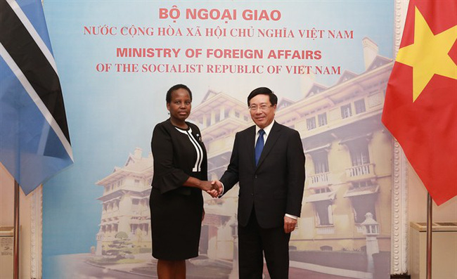 Deputy Prime Minister and Foreign Minister Phạm Bình Minh (right) holds talks with Minister of Foreign Affairs and International Cooperation of Botswana Unity Dow in Hà Nội on Monday