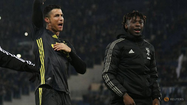 Juventus' Cristiano Ronaldo celebrates after the match with Juventus' Moise Kean. (Reuters)