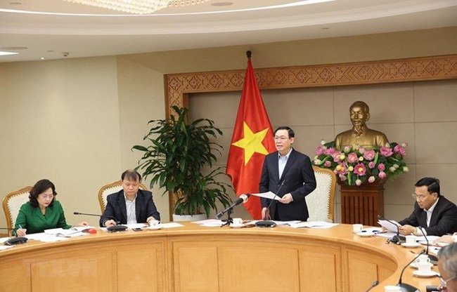 Deputy Prime Minister Vuong Dinh Hue speaks at the event. (Photo: VNA)