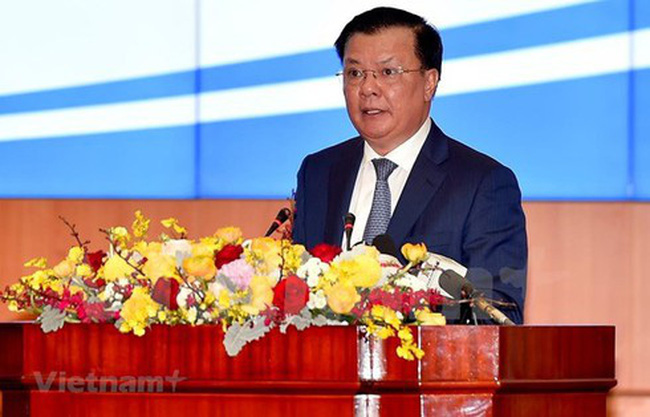 Minister of Finance Dinh Tien Dung speaks at the January 10 conference held in Hanoi to review the State budget and finance last year. (Photo: VNA)