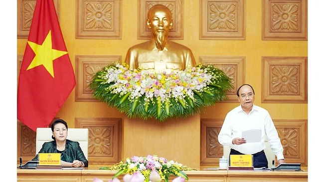 Prime Minister Nguyen Xuan Phuc, Secretary of the Government Party Civil Affairs Committee, speaks at the meeting. (Photo: QUANG KHANH)