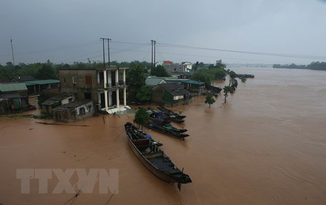 Houses submerged (Source: VNA)