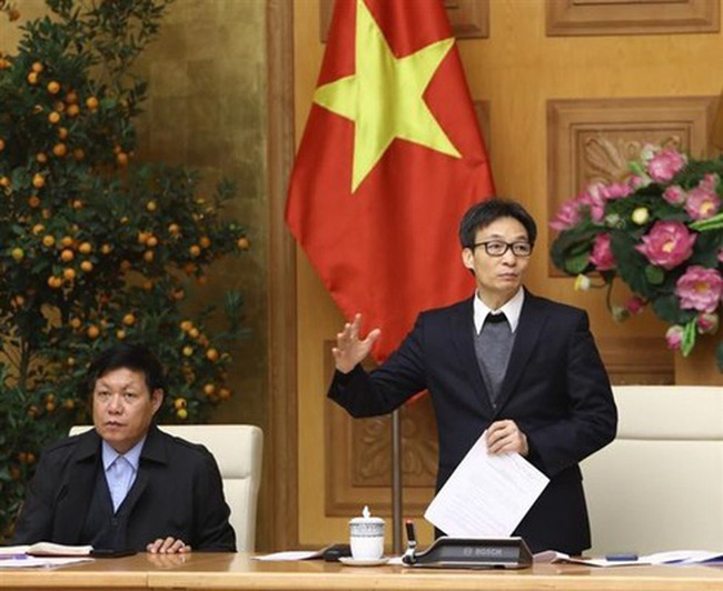 Deputy Prime Minister Vu Duc Dam (standing) at the meeting on February 14 (Photo: VNA)