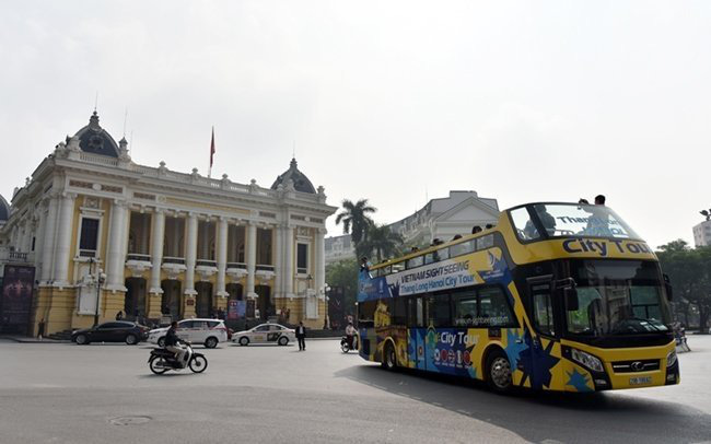 Double decker bus city tour service takes visitors around Hanoi. Photo: DANG ANH