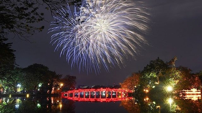 Fireworks explode over Hoan Kiem Lake in central Hanoi to welcome the year of the rat.