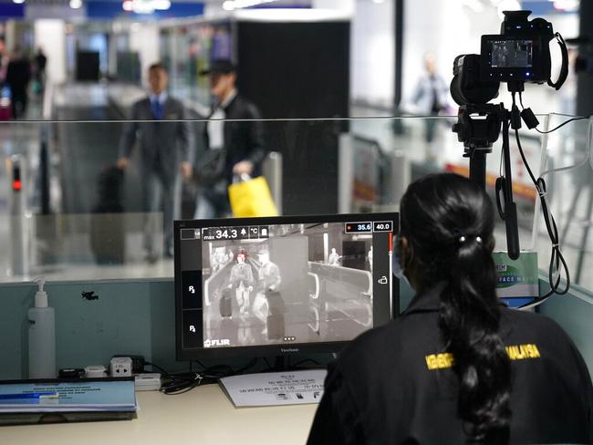 Health officials watch thermographic monitors at a quarantine inspection station at the Kuala Lumpur International Airport in Sepang, Malaysia, Tuesday, Jan. 21, 2020. (Photo: AP)