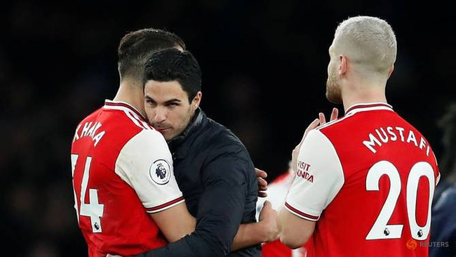Soccer Football - Premier League - Arsenal v Everton - Emirates Stadium, London, Britain - February 23, 2020 Arsenal manager Mikel Arteta celebrates with Granit Xhaka and Shkodran Mustafi after the match. (Reuters)