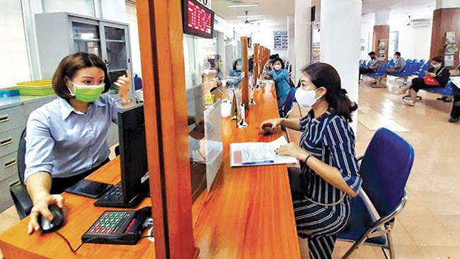Job seekers are looking for employment opportunities at a job centre in Hanoi.