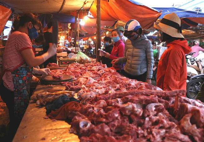 Hạ nhiệt sau nhiều ngày cố thủ: Thịt lợn giá rẻ sắp không chỉ còn có trên tivi - ảnh 4