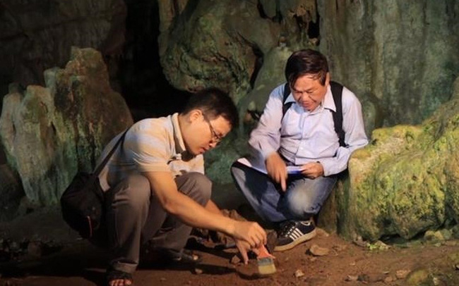Archaeologists working inside a cave in the Ba Be National Park