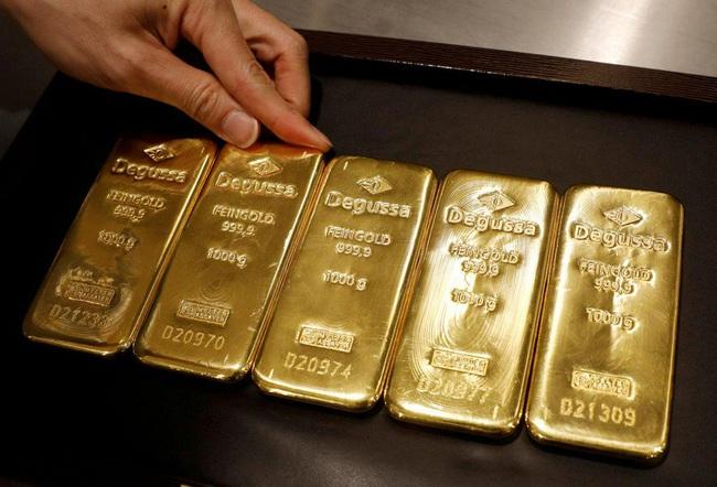 Giá vàng thế giới tăng hơn 2% trong tuần qua - ảnh 4
