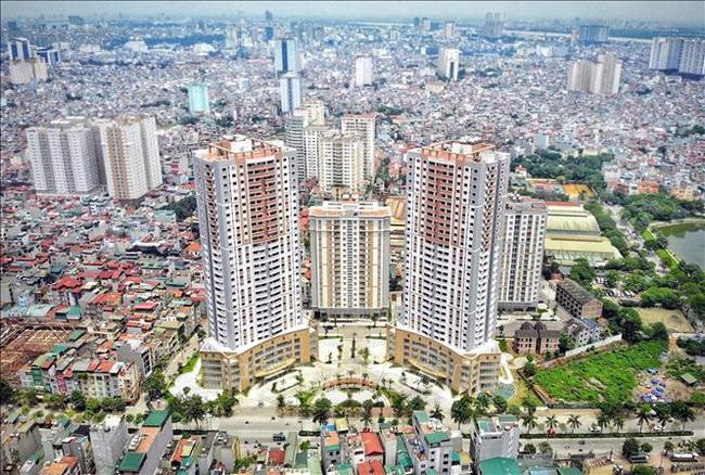 Bộ Xây dựng đề xuất sửa 2 luật tác động lớn đến thị trường bất động sản - ảnh 2