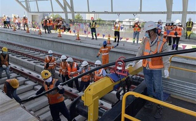 Cable pulling work on Ho Chi Minh City's Metro Line No 1 (Photo: VNA)