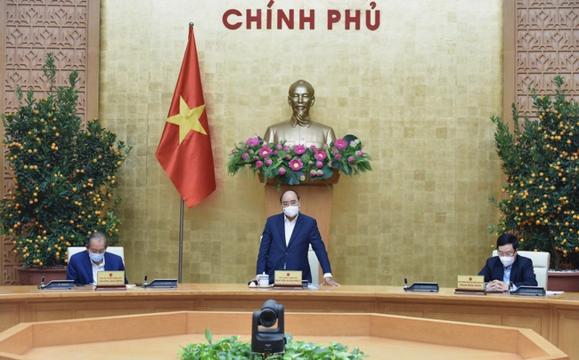 Prime Minister Nguyen Xuan Phuc chairs a Cabinet's meeting with the National Steering Committee for COVID-19 Prevention and Control in Hanoi on February 24, 2021. (Photo: NDO/Tran Hai)