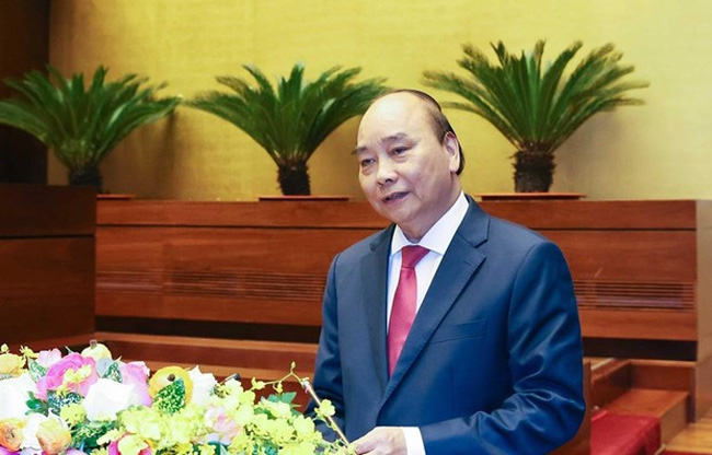 Prime Minister Nguyen Xuan Phuc presents the socio-economic development strategy for 2021-2030 and the orientations and tasks for 2021-2025 on March 28 (Photo: VNA)