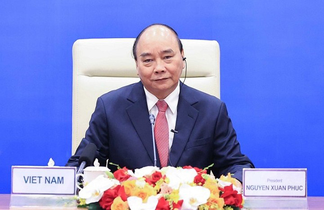 President Nguyen Xuan Phuc shares Vietnam's efforts in implementing the dual goal on pandemic fight and economic growth maintenance. (Photo: VGP)