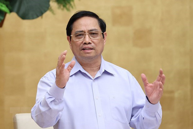Prime Minister Pham Minh Chinh speaks at the meeting. (Photo: VNA)