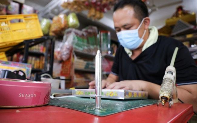Malaysia: Bán vaccine COVID-19 bằng giấy để cúng tế cho người chết - ảnh 5