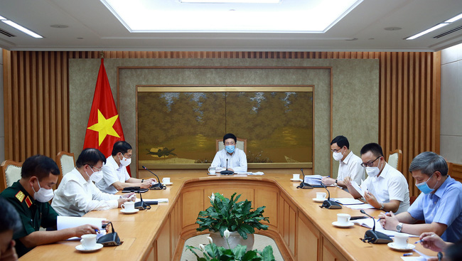 At the meeting (Photo: moh.gov.vn)