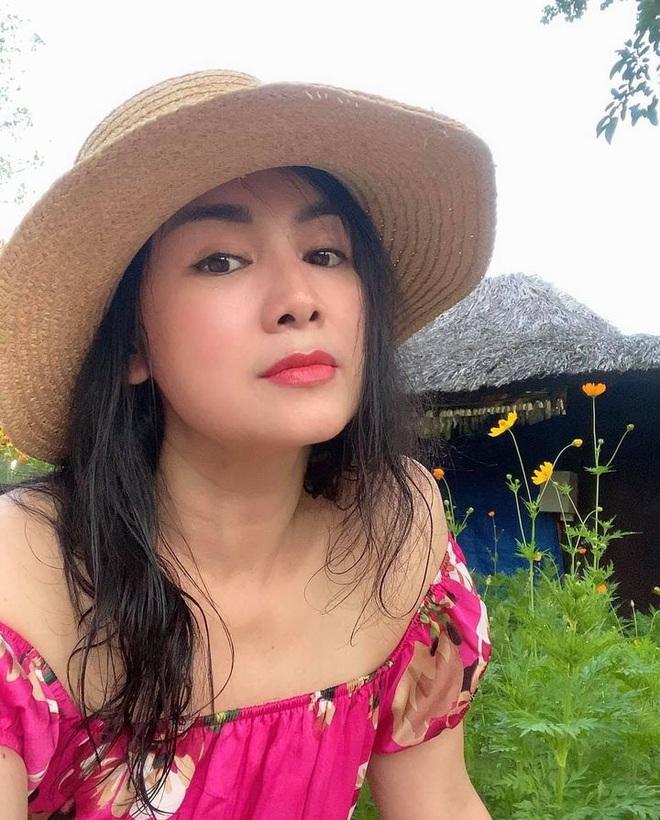 Nhan sắc đời thường trẻ đẹp của bà Cúc Hướng dương ngược nắng - ảnh 10