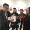 Exhibition features photos and sculptures about Vietnam