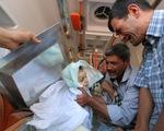 Rớt nước mắt đám tang cậu bé di cư người Syria