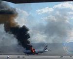 Máy bay của British Airways bốc cháy ngay trên đường băng