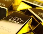 Giá vàng thế giới giảm sau tuyên bố của FED