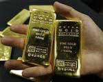 """Giá vàng thế giới tụt xuống mức """"đáy"""" trong gần 1 tuần"""