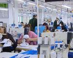 Công nhân Công ty Golden Victory Việt Nam đi làm lại sau vụ ngất xỉu