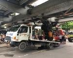 Xe cẩu gặp sự cố gây kẹt xe hàng chục km ở TP.HCM - ảnh 2