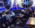 Đột kích quán bar ở Hà Nội, phát hiện hàng chục dân chơi dùng ma túy - ảnh 1